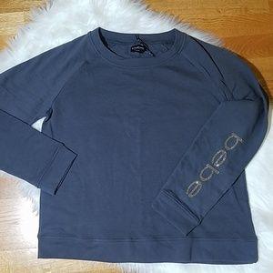 Bebe Sweatshirt w/rhinestone logo on sleeve.